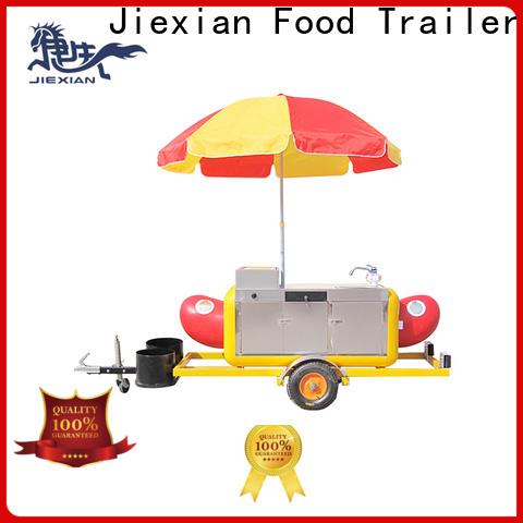 nostalgia hot dog cart with umbrella